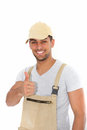 Confident workman giving a thumbs up with pleased smile of success and approval isolated on white Stock Photo