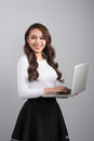 Confident young asian woman holding laptop Royalty Free Stock Photo