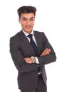 Confident young business man smiling with hands crossed Royalty Free Stock Photo
