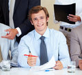 Confident young businessman signing a contract Royalty Free Stock Photography