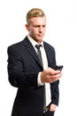 Confident young businessman using his cellphone. Stock Images