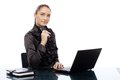 Confident young businesswoman at desk Royalty Free Stock Photo
