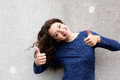 Confident young female giving thumbs up with both hands Royalty Free Stock Photo