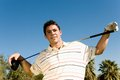 Confident Young Man With Golf Club Stock Photo