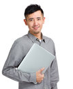 Confident young man holding laptop isolated on white Stock Photo