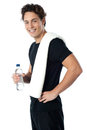 Confident young sporty guy looking at you Royalty Free Stock Photo