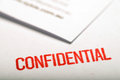 Confidential document and stamp for controlled communication Royalty Free Stock Photos