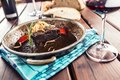 Confit beef steak with sauce fried onion bread red wine and deco Royalty Free Stock Photo