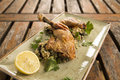 Confit chicken with lemon olive herb cous cous Royalty Free Stock Photography