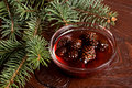 Confiture from fir cones the and branch on wooden table Stock Images