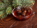 Confiture from fir cones the in dish on wooden table Royalty Free Stock Photos