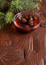 Confiture from fir cones the in dish on wooden table Royalty Free Stock Images