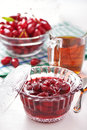 Confiture from fruits of cornel with in glass bowl Royalty Free Stock Photo