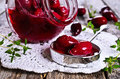 Confiture made of dogwood on a wooden surface in rustic style Royalty Free Stock Image