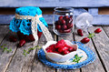 Confiture made of dogwood on a wooden surface in rustic style Stock Photo
