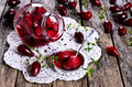 Confiture made of dogwood on a wooden surface in rustic style Stock Photography