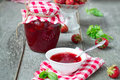 Confiture with strawberries and basil on a wooden background Stock Image