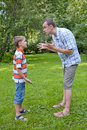 Conflict of father and son, park Stock Image