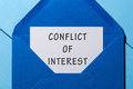 Conflict of interest text written in letter at blue envelope Royalty Free Stock Photo