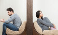 Conflict between man and woman men women sitting on either side of a wall Stock Images