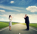 Conflict between senior man and young woman men women on the road Stock Photo