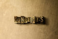 CONFLICTS - close-up of grungy vintage typeset word on metal backdrop Royalty Free Stock Photo
