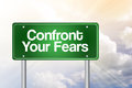 Confront your fears green road sign business concept Stock Photo