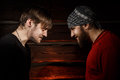 Confrontation conceptual picture two brutal men looking into each other s eyes Royalty Free Stock Photos