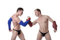 Confrontation of sexy guys dressed as superheroes isolated on white background Royalty Free Stock Photo