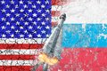 Confrontation between the USA and Russia. Threat of nuclear strike. The flags of two countries painted on the concrete wall.