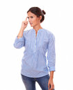 Confused adult brunette wondering while standing portrait of on blue blouse and looking to her right on isolated white background Royalty Free Stock Image