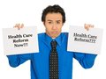 Confused business man holding healthcare reform sign puzzled portrait young uncertain undecided isolated on white background pros Royalty Free Stock Images
