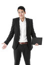 Confused businessman with a tablet in suit Royalty Free Stock Photography