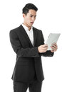 Confused businessman using tablet in black suit Royalty Free Stock Photography
