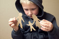 Confused child with broken paper family Royalty Free Stock Photo