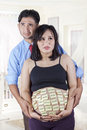 Confused couple making baby names portrait of asian shot in the bedroom at home Royalty Free Stock Photos