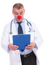 Confused fake doctor acting like a clown because he can t unerstand the results of treatment Stock Photo