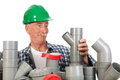Confused funny plumber by assortment pvc tubes Royalty Free Stock Images