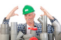 Confused funny plumber by assortment pvc tubes Stock Images