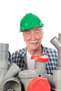 Confused funny plumber by assortment pvc tubes Royalty Free Stock Photo