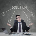 Confused man to choose a solution caucasian employee in business suit with expression Royalty Free Stock Image