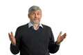 Confused mature man on white background. Royalty Free Stock Photo