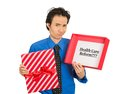 Confused skeptical man holding sign health care reform in gift box closeup portrait young uncertain of universal insurance Royalty Free Stock Photography