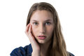 Confused teenage girl with hand on face Royalty Free Stock Photo
