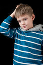Confused young boy Royalty Free Stock Photo