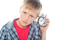 Confused young kid holding time piece Royalty Free Stock Photo