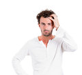 Confusion closeup portrait young business man thinking trying to remember something confused looking for right answer isolated Royalty Free Stock Photography