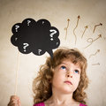 Confusion confused child with paper cloud Royalty Free Stock Images
