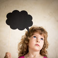 Confusion confused child with paper cloud Stock Images