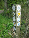 A confusion of footpaths post displaying footpath signs on the uk s public footpath network Stock Photography